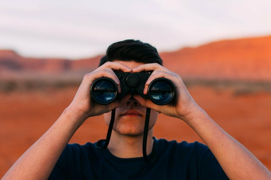 Person with binoculars searching for something
