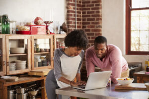 couple engaging with a real estate website