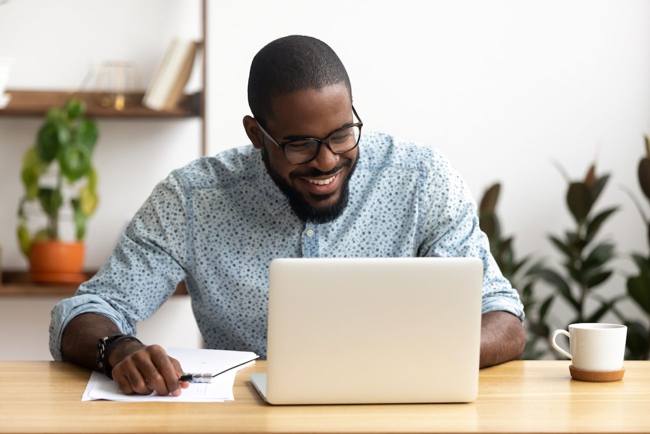 Real Estate Broker working on their CRM on laptop